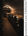 Old wine barrels in the vault of winery 59992007