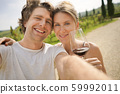 Young couple doing selfie. Travel. 59992011