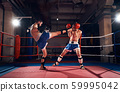 Boxers training kickboxing in the ring at the health club 59995042