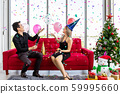 Attractive young couple celebrate Christmas New 59995660