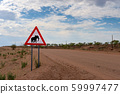 Elephant crossing warning road sign placed in the desert of Namibia 59997477