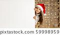 little child girl in red santa hat holding white banner 59998959