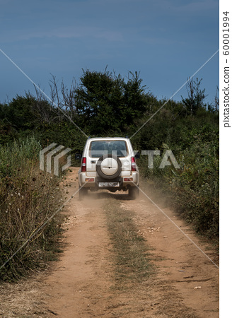 Cross Country Vehicle SUV On Dusty Gravel Road In Croatia 60001994