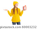 portrait of a girl with a gift in one hand over white background 60003232