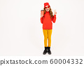 girl in a red hat with a glass in hand on a white background 60004332