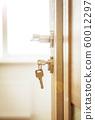 Door lock , door open in front of room blur background 60012297