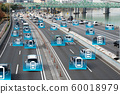 Electric car concept running on the road 60018979