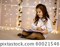 child girl is reading book 60021546