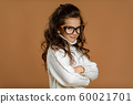 Cute curly little child girl in glasses 60021701