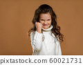 angry screaming little child girl in white sweater 60021731