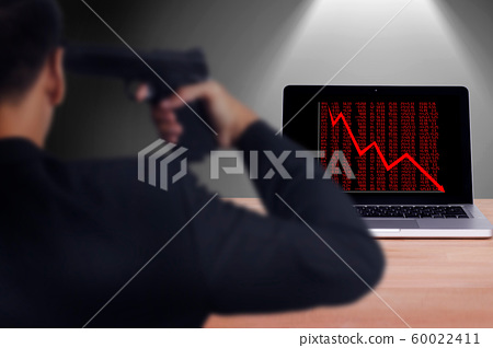 businessman hold handgun point to his head for suicide attempt after lose money from stock trade. stocks fall on economic downturn, causing people to play stress concept 60022411