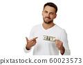 man holding money banknotes 60023573