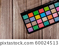 Make up palette, eye shadows in black box. 60024513