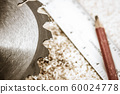 Saw Blade and Woodwork tools on the boards background 60024778