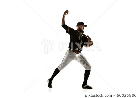 Baseball player, pitcher in a black uniform practicing on a white background. 60025986
