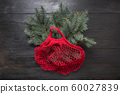 Christmas zero waste. Fir tree in red mesh bag 60027839