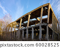 Ruined concrete industrial structure in forest at 60028525