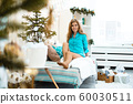 Pensive young woman celebrating Christmas. Woman woke up in the new year 60030511
