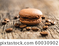 Sweet macarons with coffee flavor. 60030902