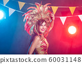 Holidays, party, dance and nightlife concept - Beautiful woman dressed for carnival night 60031148