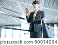 Business woman airport 60034994