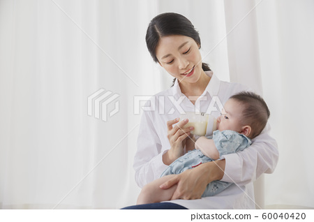 Happy young parents with baby 167 60040420