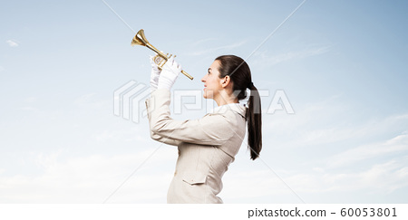 Woman playing trumpet brass instrument 60053801