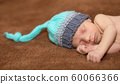 Baby boy sleeping on a carpet at home 60066366