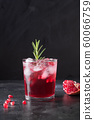 Pomegranate Christmas cocktail with rosemary. 60066759