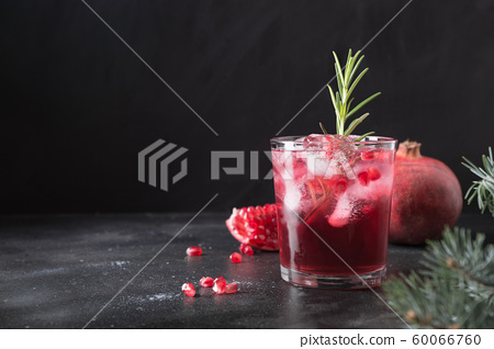 Pomegranate Christmas cocktail with rosemary. 60066760