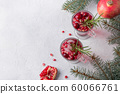 Pomegranate Christmas cocktail with rosemary. 60066761