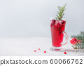 Pomegranate Christmas cocktail with rosemary. 60066762