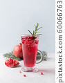 Pomegranate Christmas cocktail with rosemary. 60066763