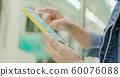 asian woman use smartphone 60076088