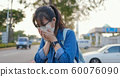 woman feel sick and cough 60076090