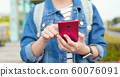 asian woman use 5G smartphone 60076091