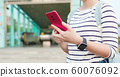 asian woman use 5G smartphone 60076092