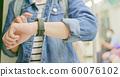 woman look wearable smart watch 60076102