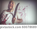 Mad butcher with large knife 60078689