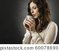 Beautiful happy redhead woman drinking coffee 60078690