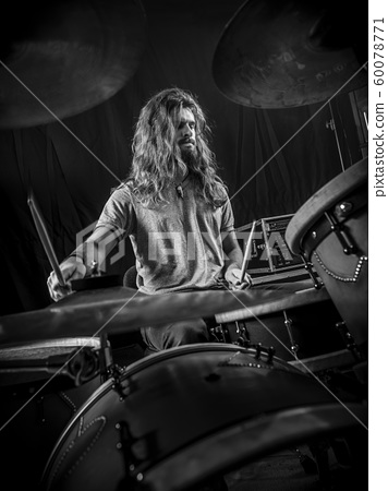 Young man playing the drums on stage 60078771