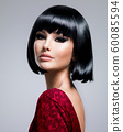 Beautiful brunette woman with bob hairstyle. 60085594