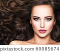 Beautiful woman with long bown hair 60085674