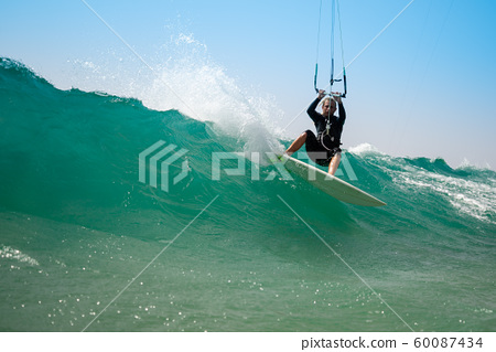 The kite surfer rides the waves of the Atlantic Ocean 60087434