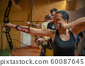 sports archery at the shooting range, competition for the most points to win the cup 60087645