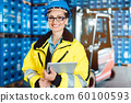 Worker woman in a logistics company with a tablet computer 60100593