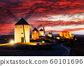 Windmills at sunset in Consuegra, Castile-La Mancha, Spain. 60101696