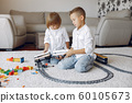 Children playing with lego and toy train in a playing room 60105673