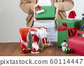 Woman holding gift box. 60114447