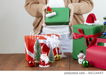 Woman holding gift box. 60114447